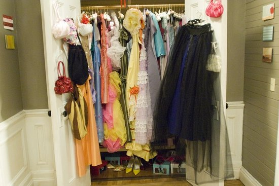 A closet full of bridesmaid dresses takes center stage on the set of 27 DRESSES. (Courtesy of PopSugar)