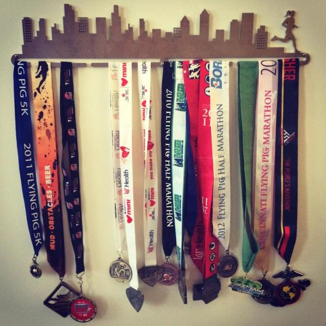 Erin's victory wall of half marathon medals